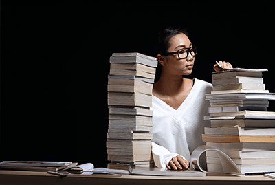 shutterstock_1084179056-asian-woman-mag-stack