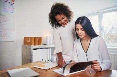 shutterstock_668141788_two women with article resized