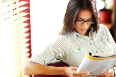 shutterstock_200247056 young woman reading article resized