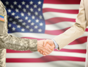 shutterstock_769489723_flag and handshake