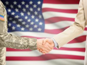 shutterstock_769489723_flag and handshake