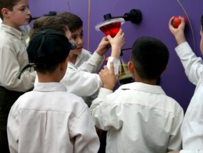 Children participating in creative activities while learning sci